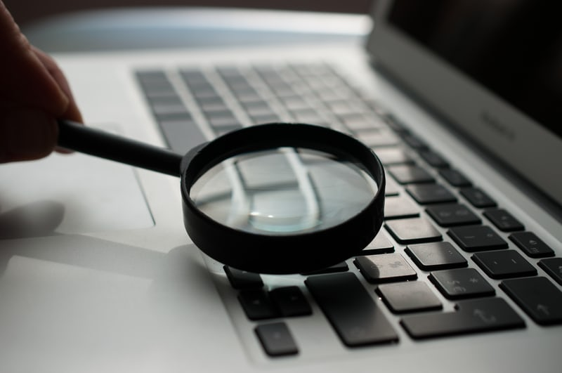 Examine a keyboard with magnifying glass